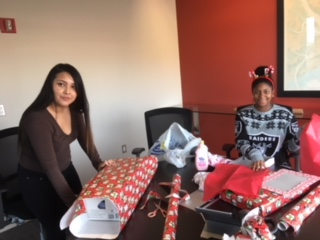 BPG associates wrapping presents